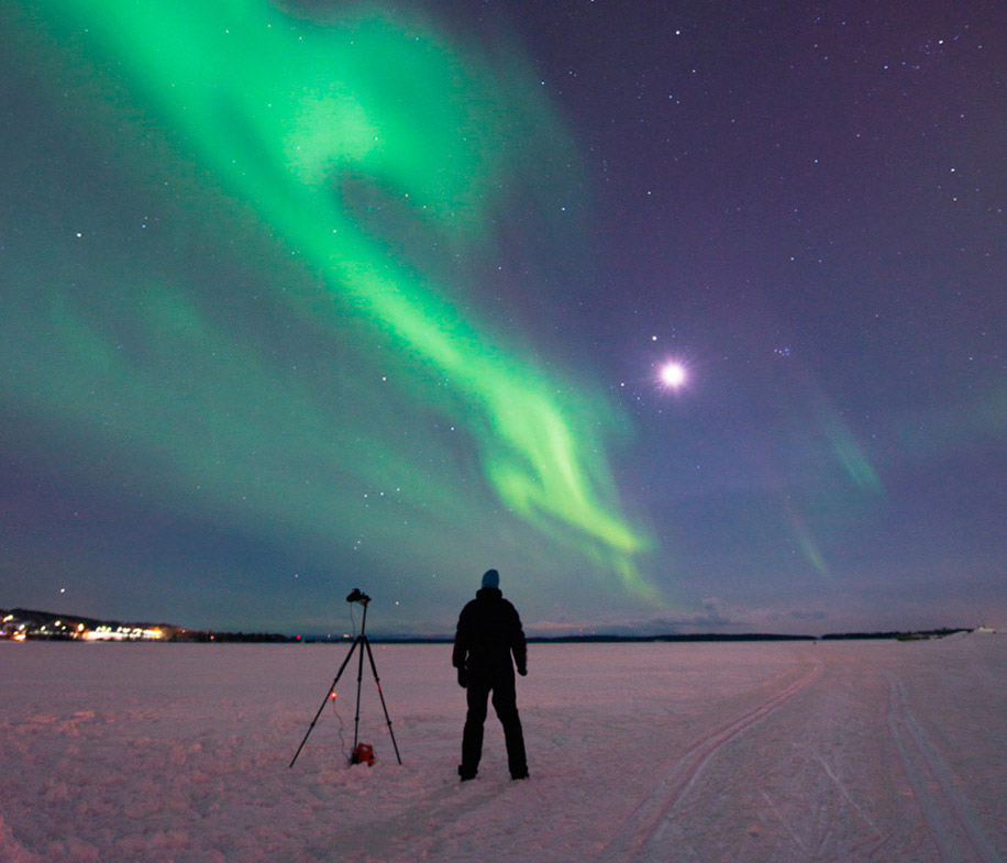 Photographer photographing the aurora